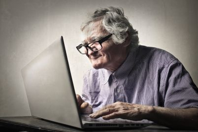 bigstock-Elderly-man-using-technology-85082627.jpg