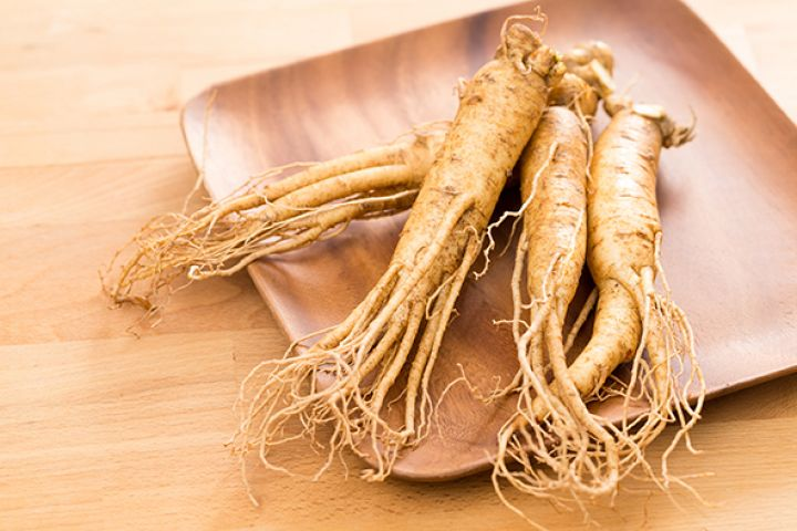 bigstock-Ginseng-root-over-wooden-backg-179924365.jpg