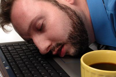 bigstock-Man-Asleep-On-Laptop-With-Cup-5671.jpg