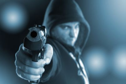 bigstock-Serious-gangster-is-aiming-a-g-43841074.jpg