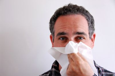 bigstock-Sick-Man-Blowing-Nose-600657.jpg