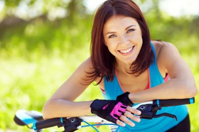 bigstock-Young-woman-and-bike-118787093-1024x683-1.jpg