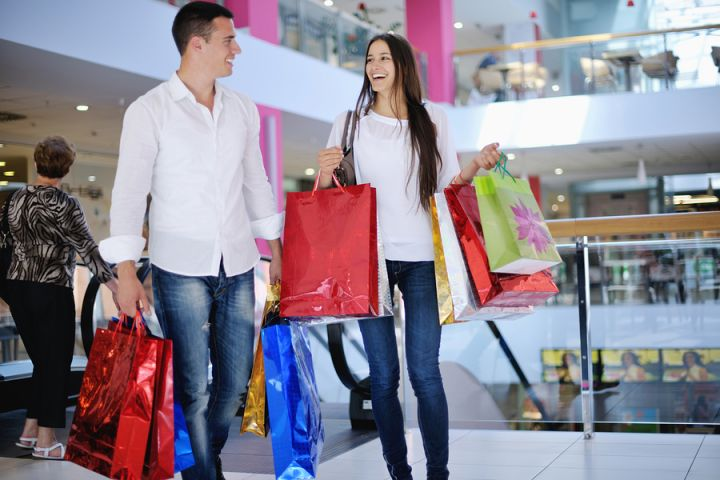 bigstock-happy-young-couple-with-bags-i-61414616.jpg